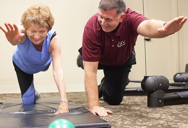 Independent living resident working with a trainer in the state-of-the-art fitness center
