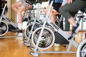 independent living residents taking an indoor cycling class