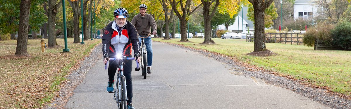 Senior living residents biking around the pastoral campus at White Horse Village