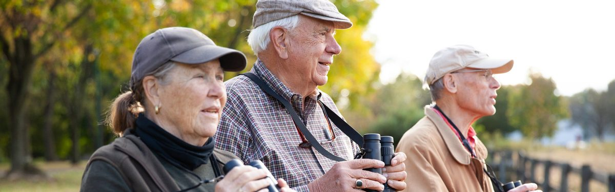 Independent living residents Birdwatching in the beautiful meadow at White Horse Village