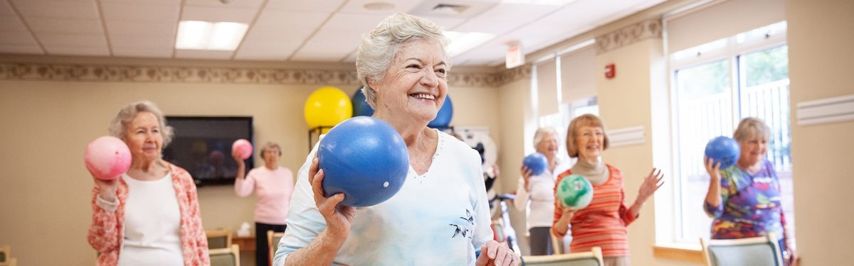 Numerous residents participate in a group exercise fitness class