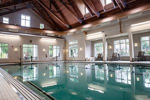 Beautiful indoor aquatic center with large swimming pool and jacuzzi