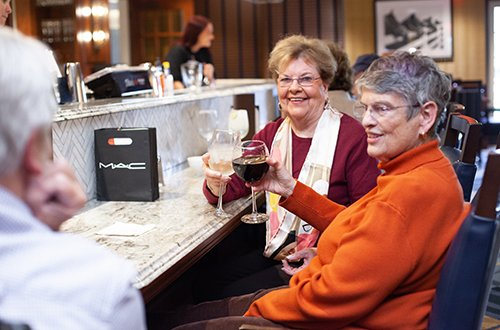 Residents enjoy handmade cocktails in the modern White Horse Tavern