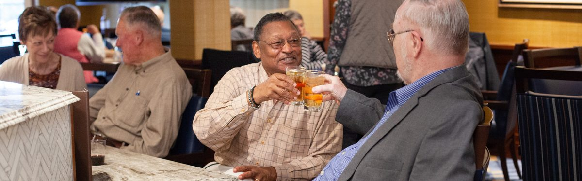 Residents enjoy cocktails during happy hour in the White Horse Tavern