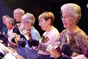 Bell Ringers rehearse in the White Horse Village auditorium