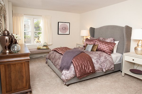 Bedroom of an independent living Apartment Home with elevator access to all amenities