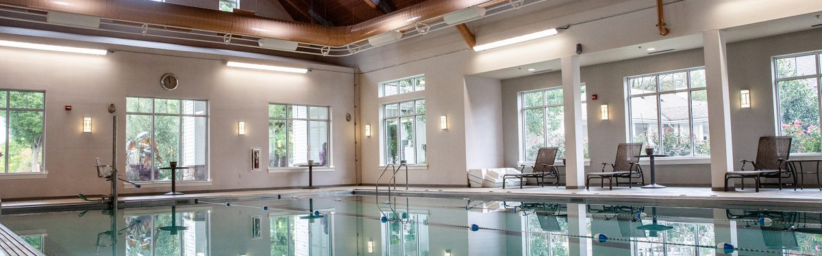 Indoor aquatic center featuring a lap swimming pool and jacuzzi