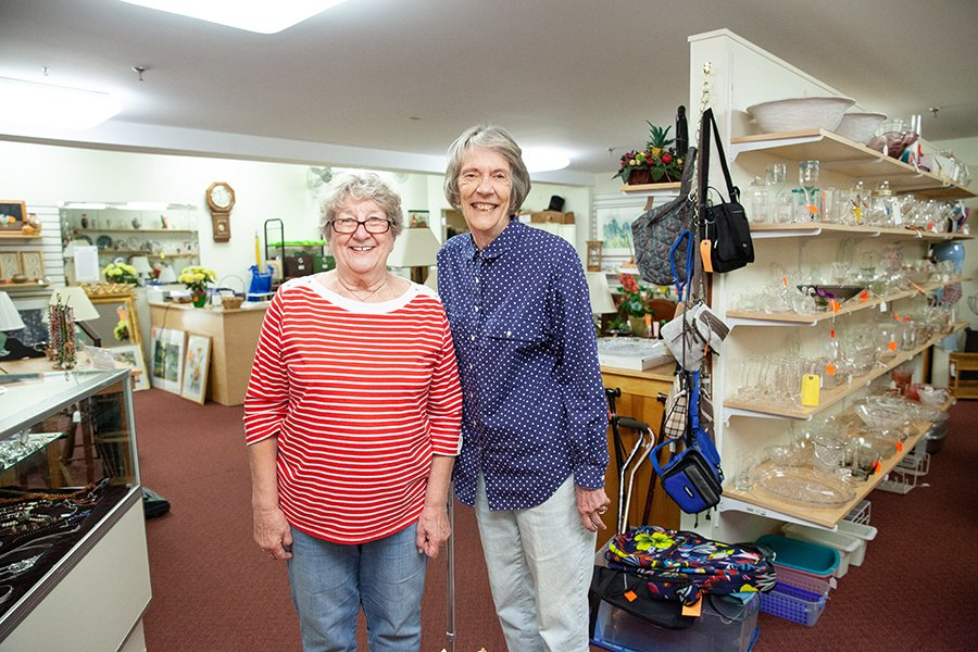 Two women volunteers in the Stall, a community resale shop
